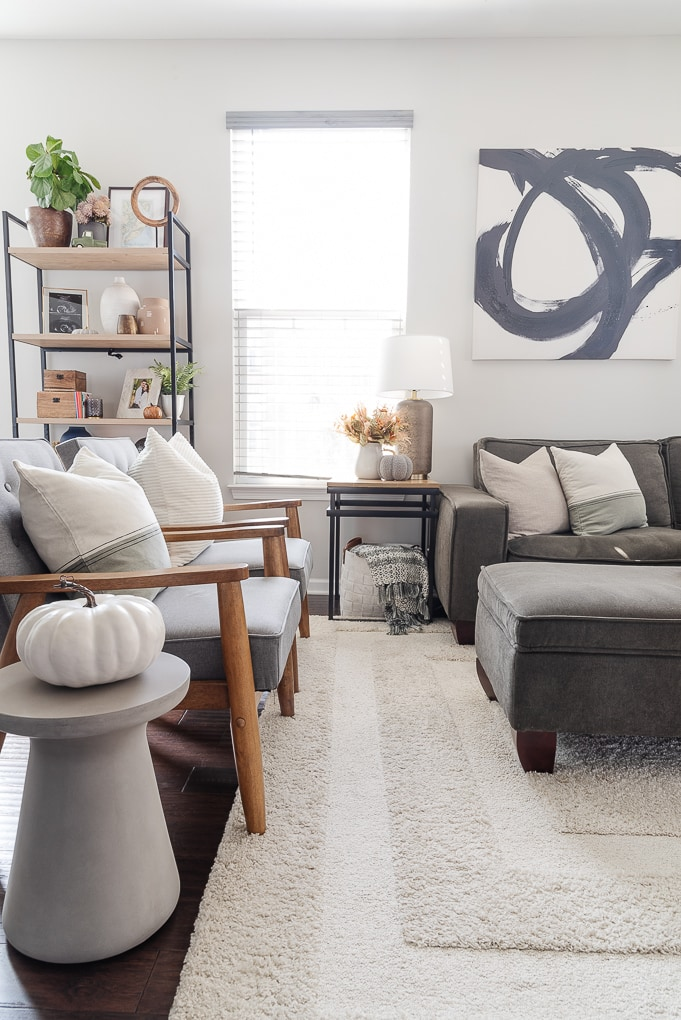 fall living room with accent chairs and bookshelf