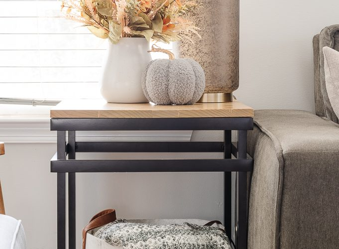 end table with felt basket and throw blanket underneath