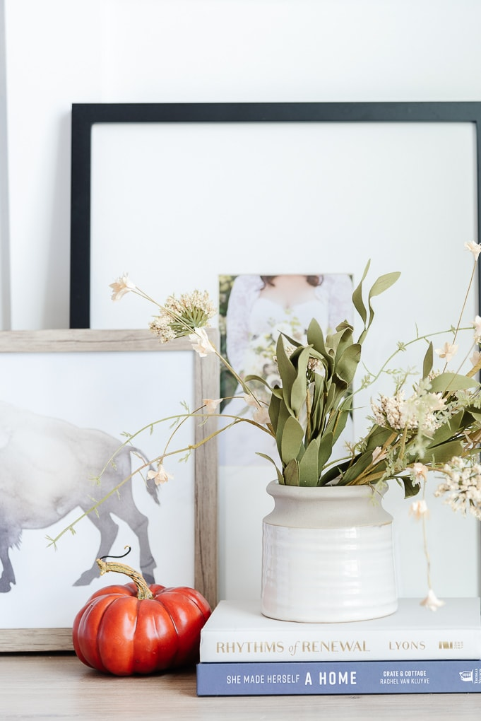 studio mgcee cream and brown vase with fall floral stems on nightstand