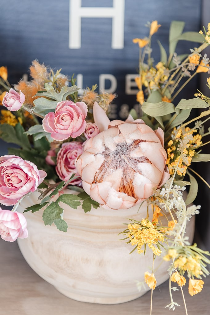 colorful fall florals in pale wooden vase