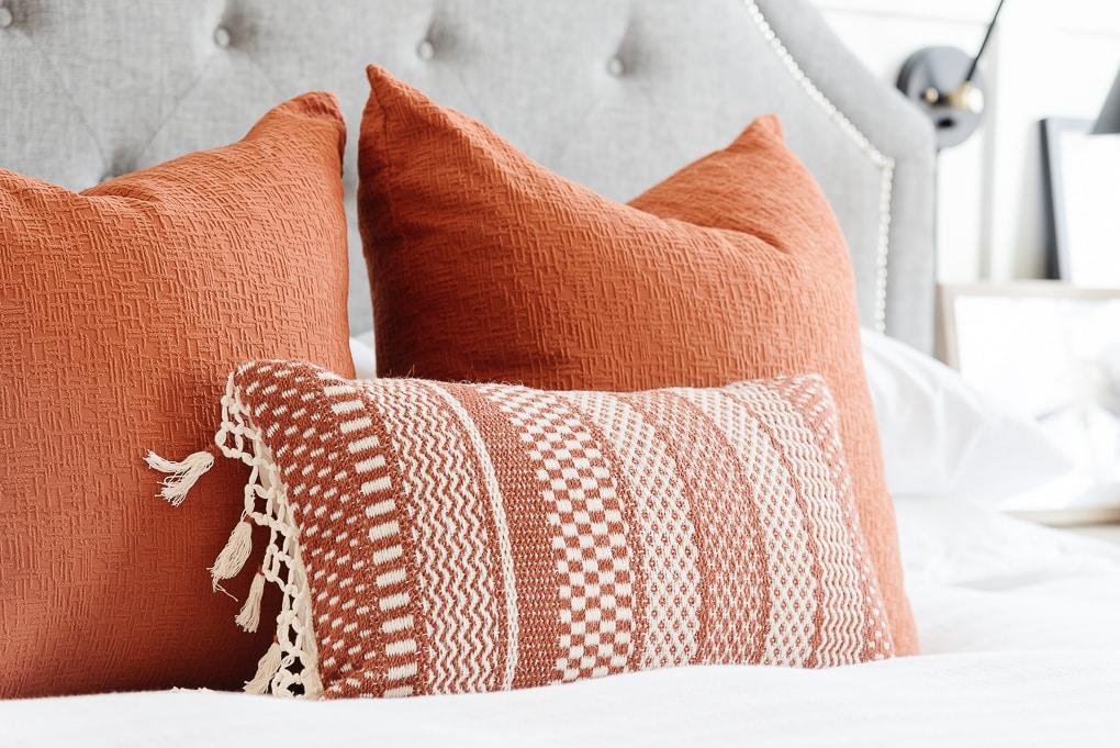 burnt orange pillows on bed