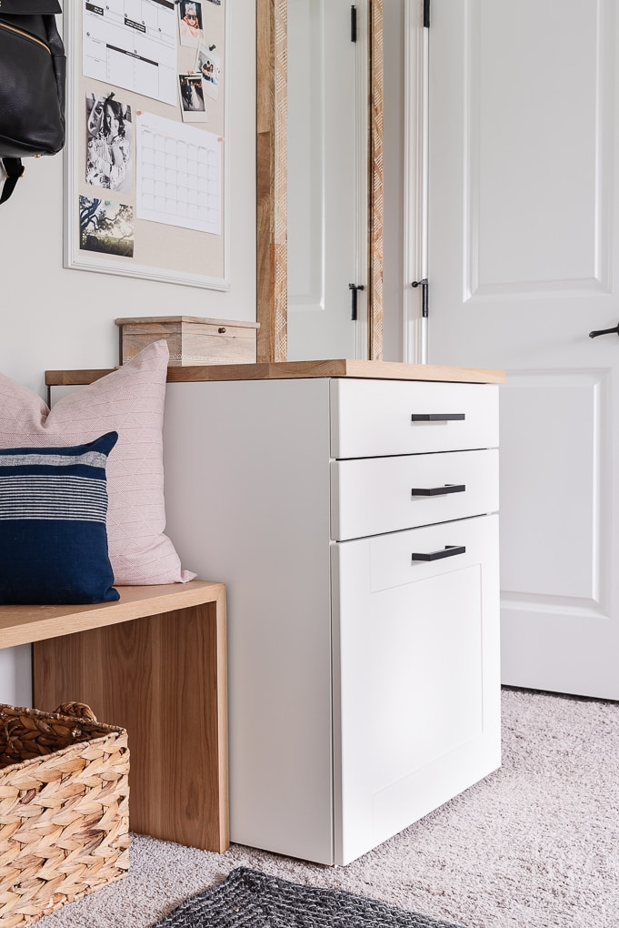 ikea sektion cabinet used in mudroom entryway for command center
