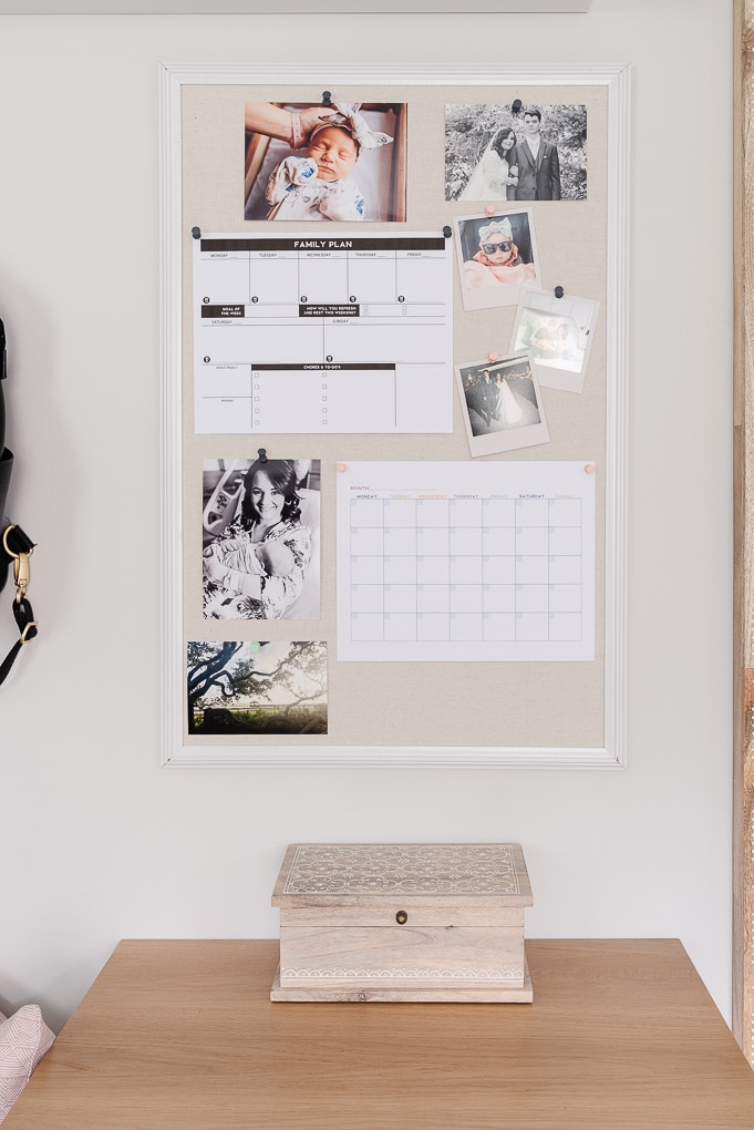 bulletin board with family photos and printables to make a command center
