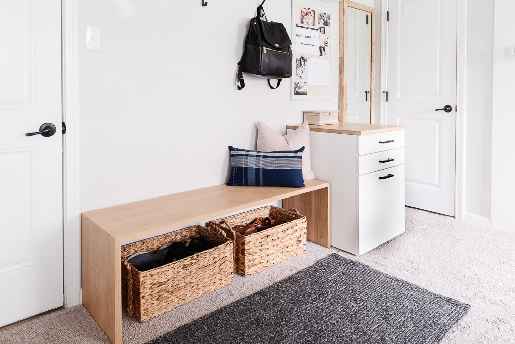 wooden white oak waterfall bench with baskets for shoes