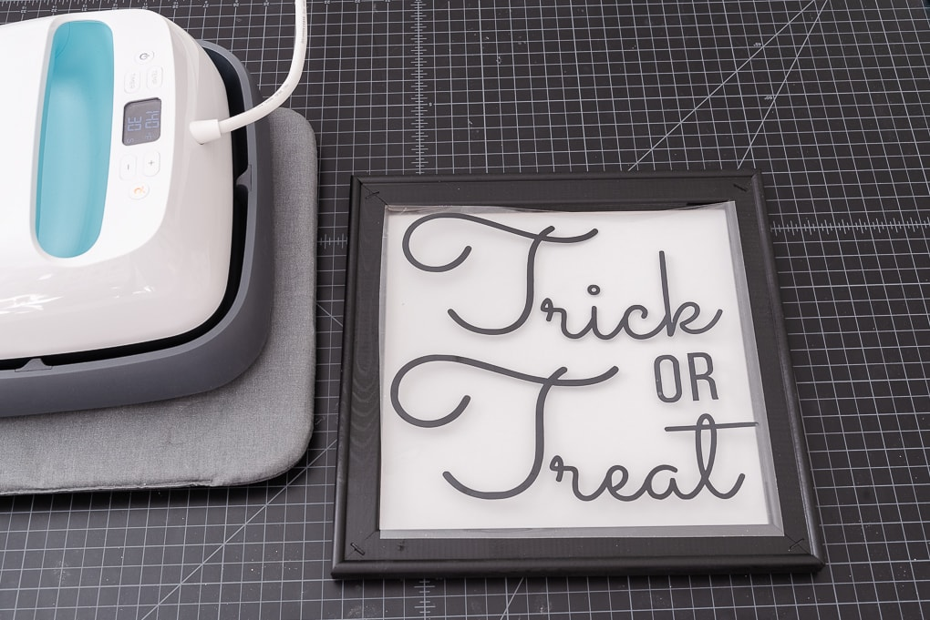 trick or treat vinyl design on top of white canvas