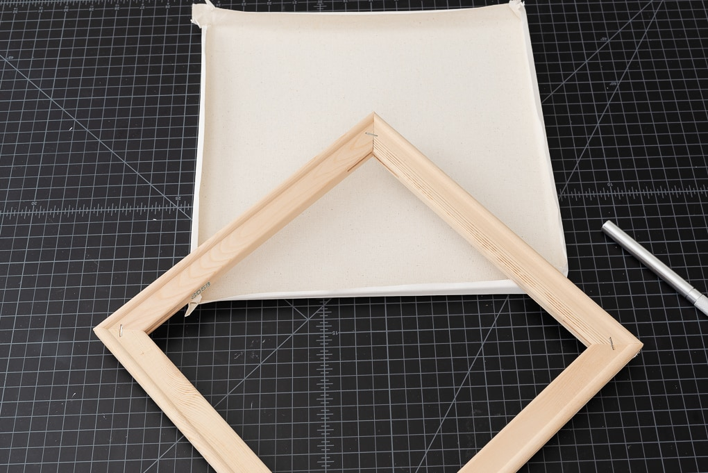 white canvas and wooden frame separated