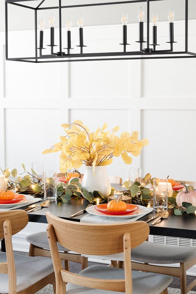 thanksgiving table decor centerpiece white vase with yellow eucalyptus