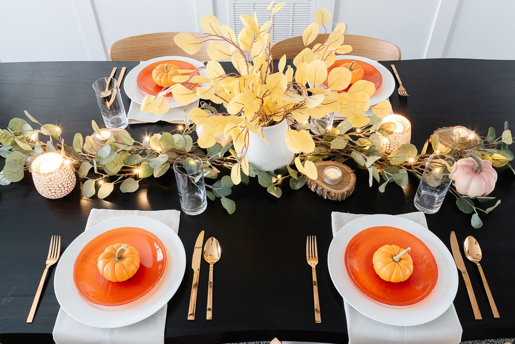 overhead view of modern thanksgiving table on black wooden table