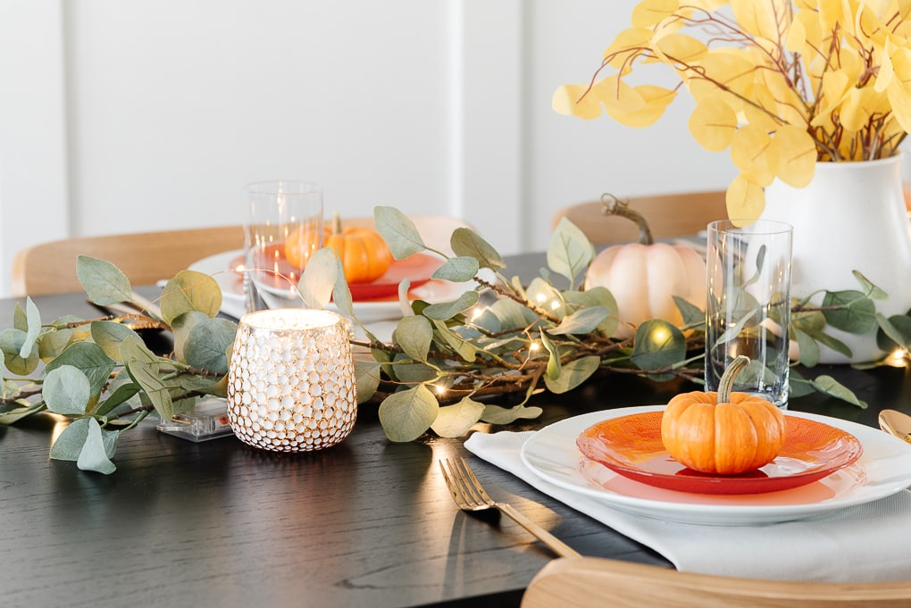 candle votives with faux eucalyptus thanksgiving table decor