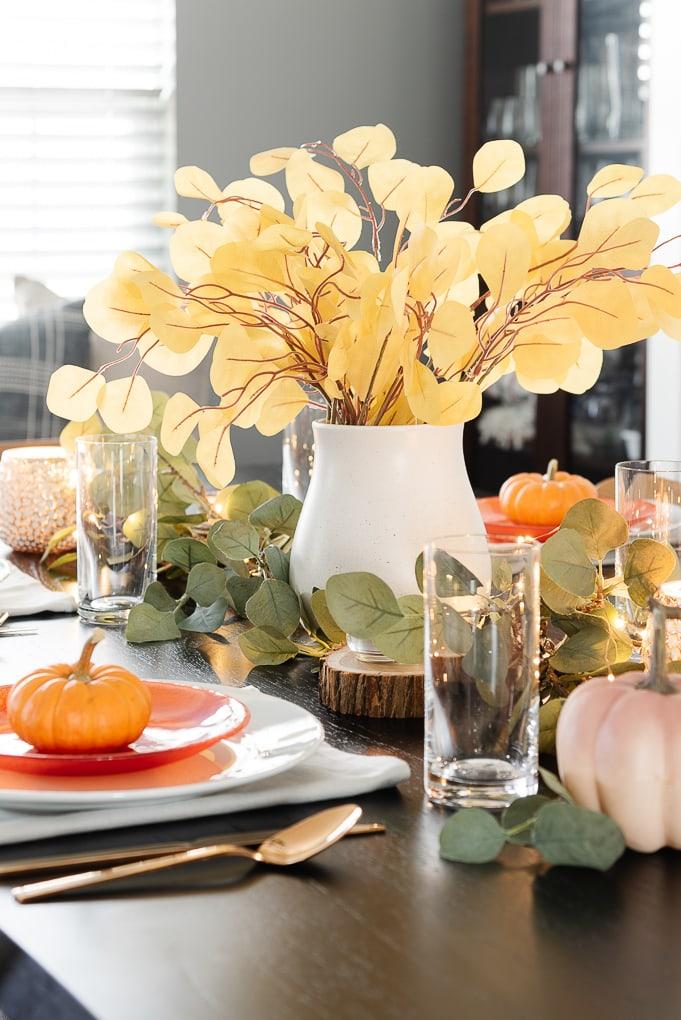 thanksgiving centerpiece white vase and yellow eucalyptus