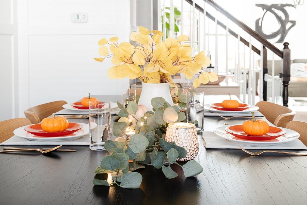 faux eucalyptus on black table thanksgiving decor
