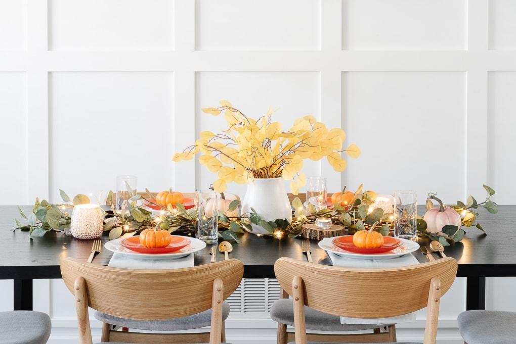 modern thanksgiving table decor with eucalyptus and white vase centerpiece