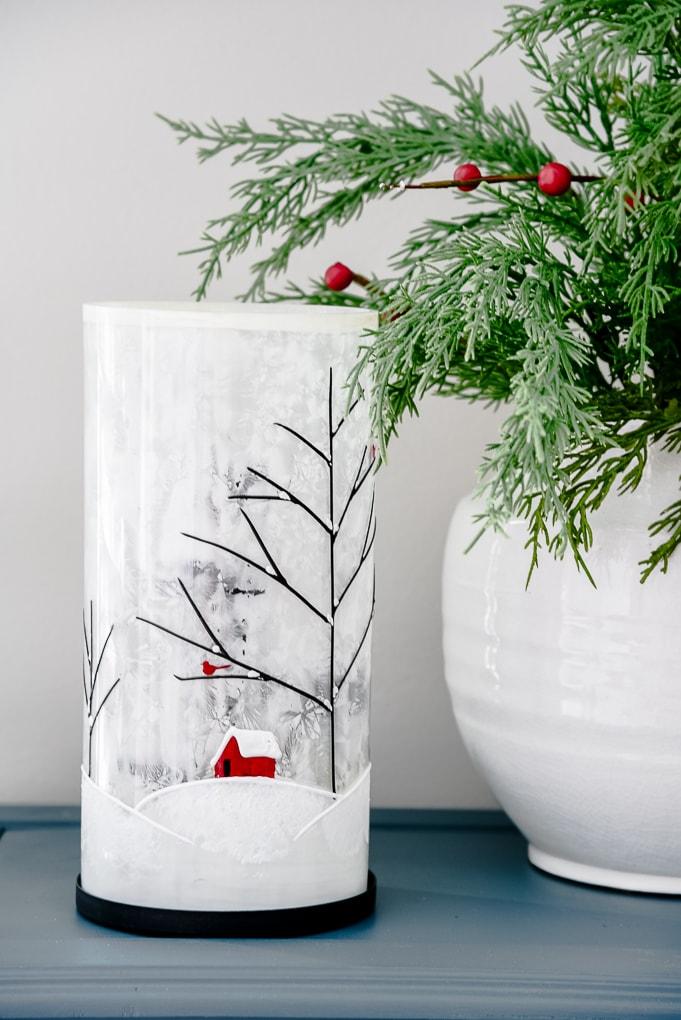 winter luminary next to white vase