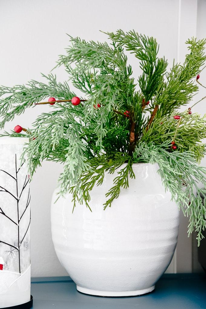 white vase with Christmas greenery