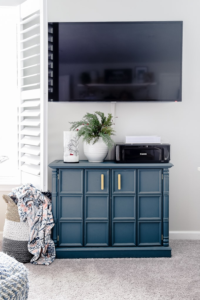 blue accent cabinet with Christmas decorations
