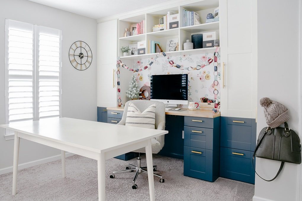 modern home office with built in desk decorated for Christmas