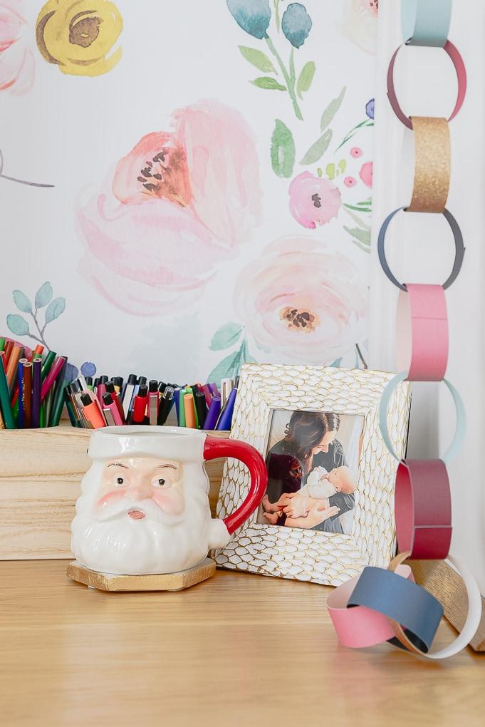 Santa mug on desk with colorful paper chain
