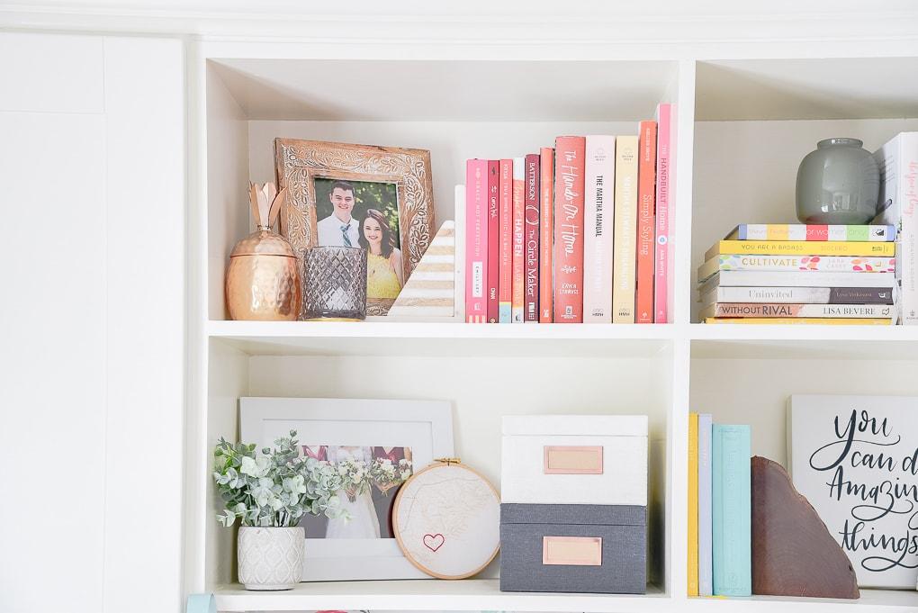 styled bookshelves colorful winter decor