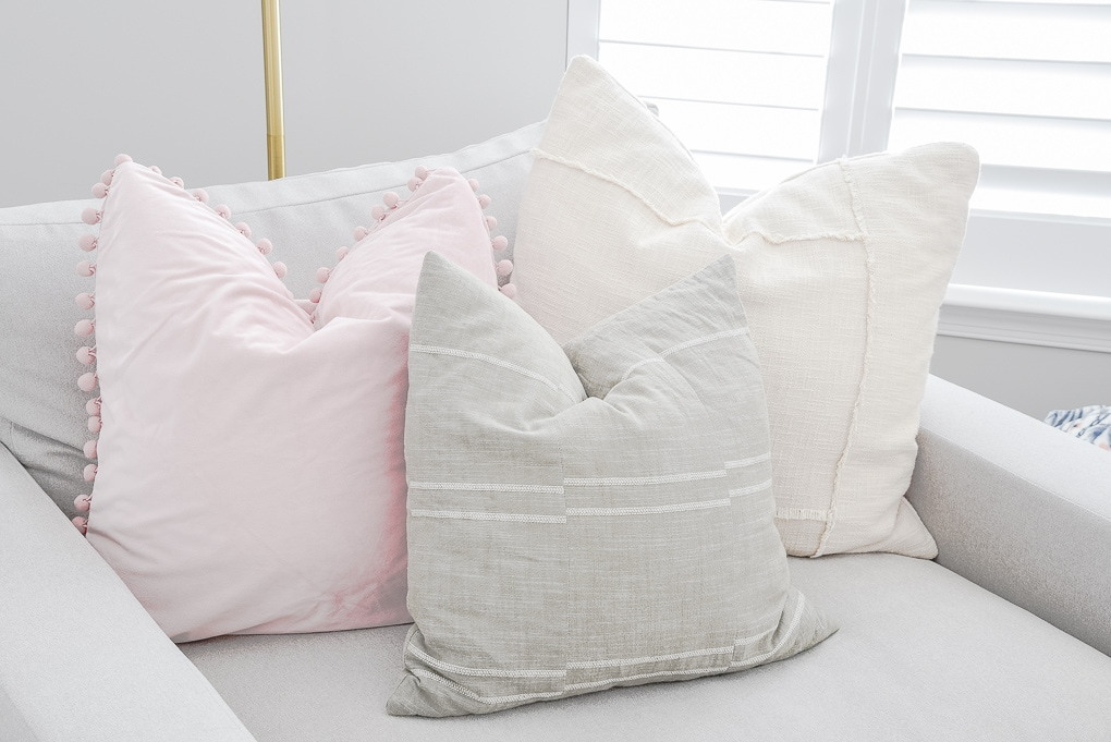 colorful pillow combination pink green and cream