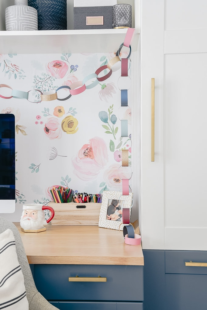 colorful Christmas paper chain against removable wallpaper wall