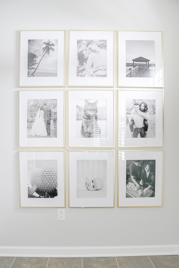 modern gold gallery wall frames with black and white photos