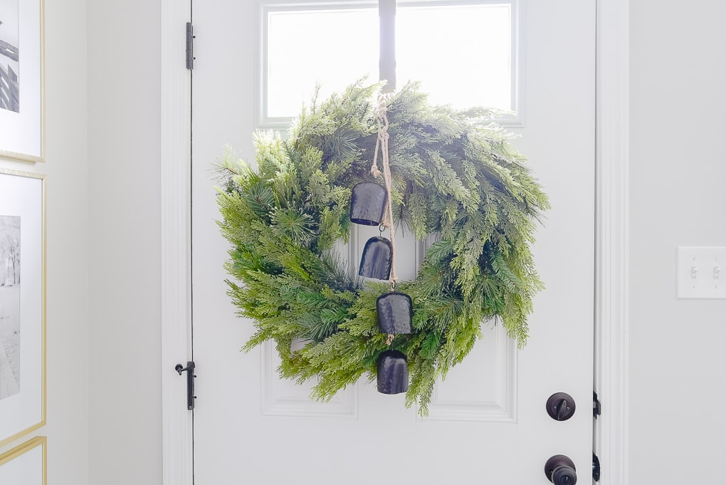 mcgee and co Christmas greenery wreath on door with black bells