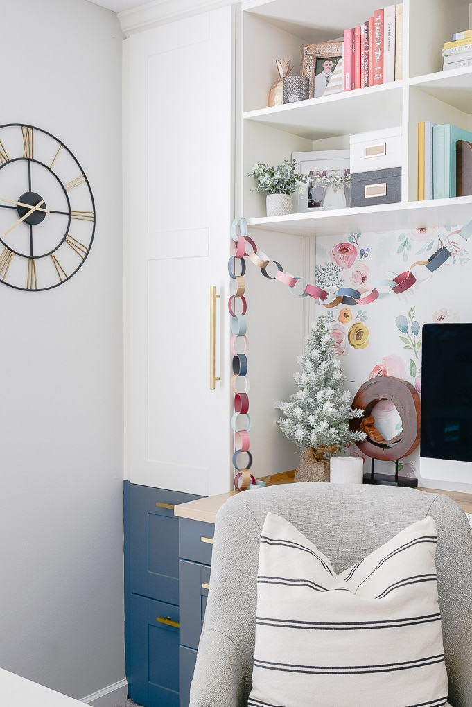 colorful Christmas decorations in a home office built in desk