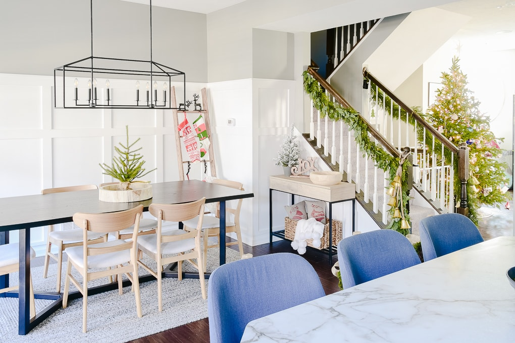 Christmas dining room decorated with festive modern styled decor and stocking ladder