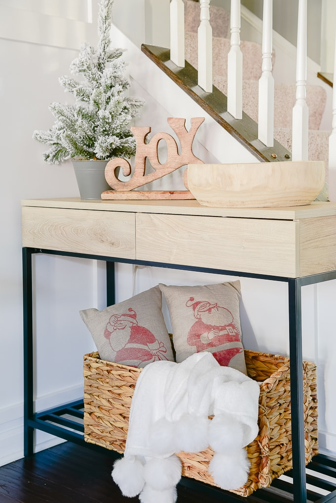 modern console table with Christmas decor styled on top