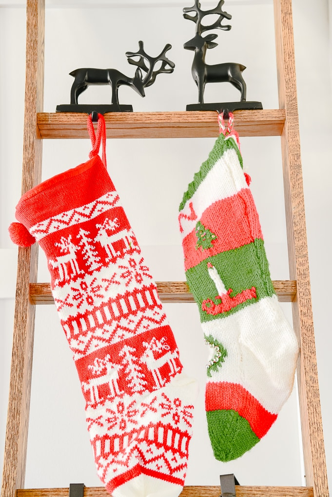 red and green knitted stockings on ladder
