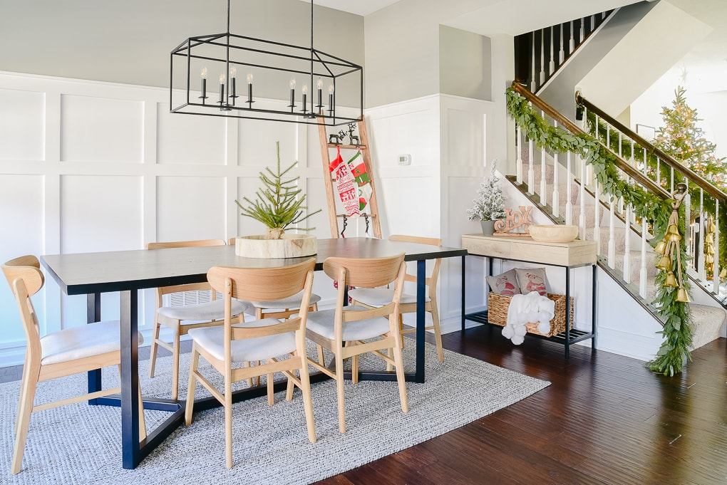 dining room decorated for Christmas with modern festive decor