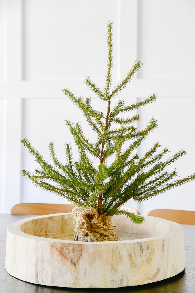 tabletop sparse Christmas tree in wooden round tray