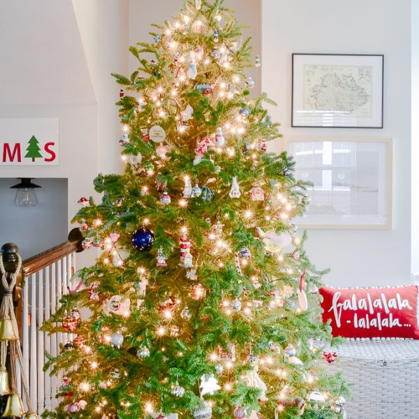 fresh Christmas tree decorated in modern classic living room with family ornaments