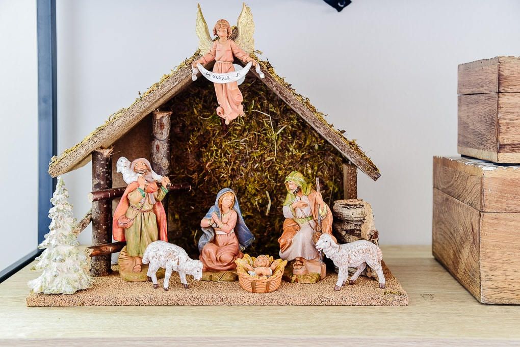 traditional nativity scene on shelf in living room