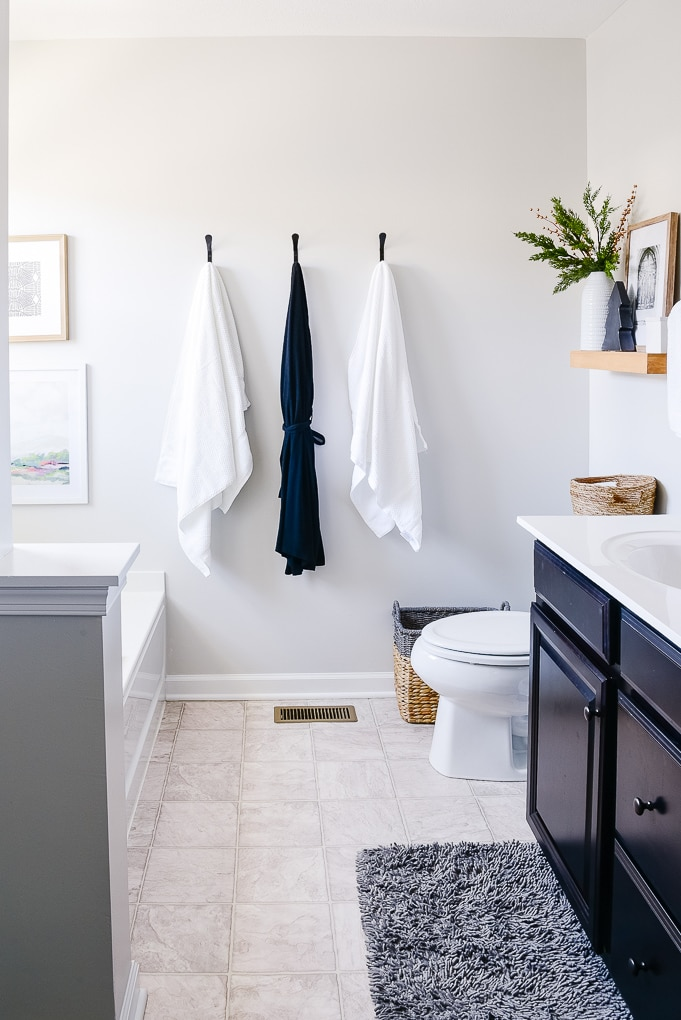 white towels and robe hanging in master bathroom christmas