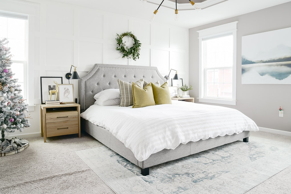 modern natural master bedroom decorated for Christmas