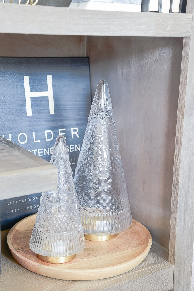 Target Scandinavian glass christmas tree figurines on wooden tray on bookshelf