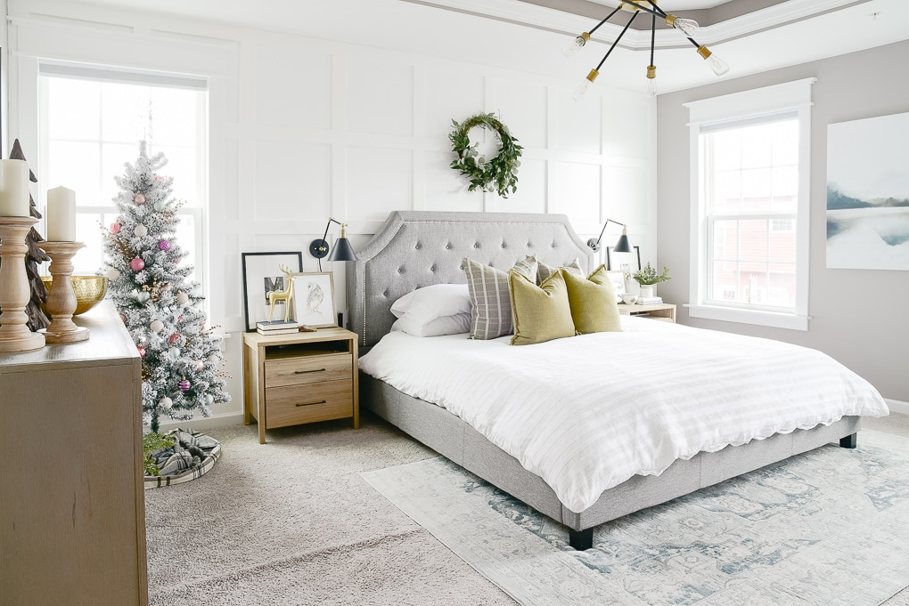 modern and natural christmas bedroom with flocked christmas tree in the corner