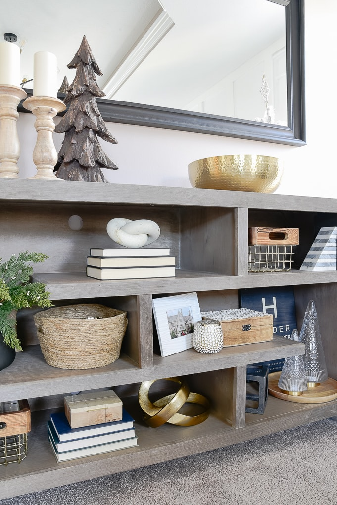 gray bookshelves decorated and styled for Christmas