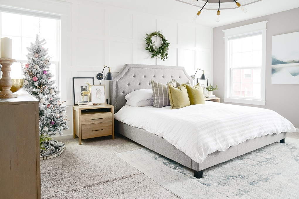 christmas master bedroom decorated with flocked christmas tree