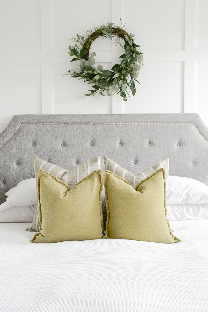 olive green pillows on white bedding in master bedroom