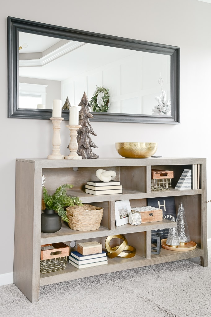 styled and decorated gray bookshelf in master bedroom decorated for christmas
