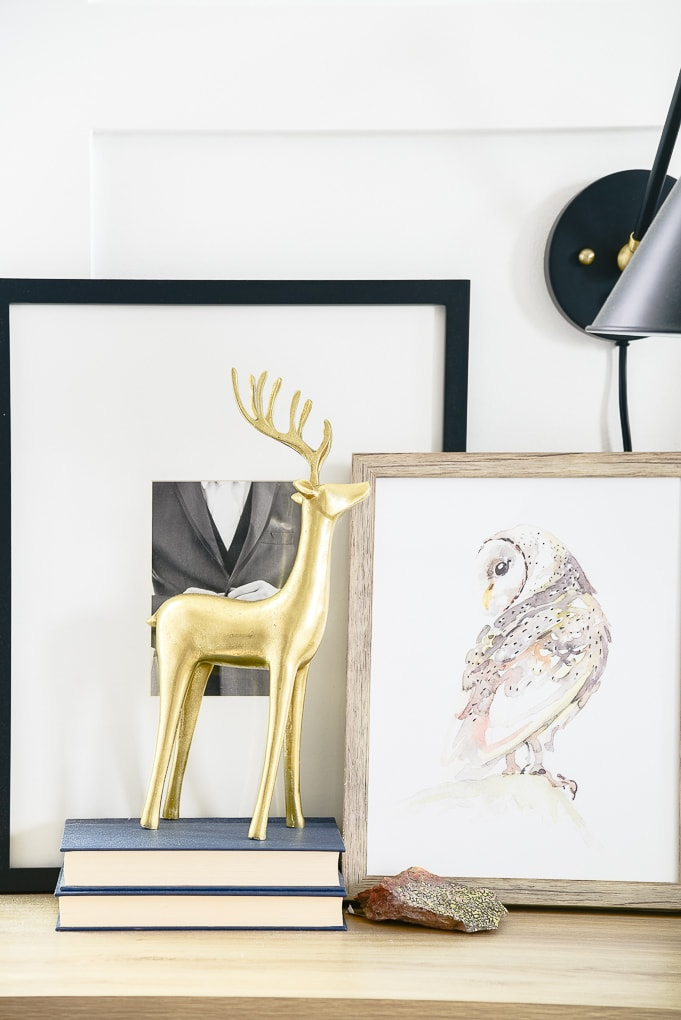 gold reindeer figurine on books on nightstand in master bedroom decorated for christmas