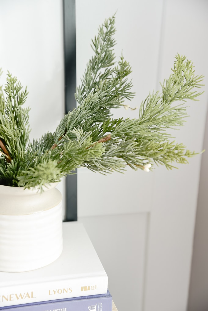 faux christmas greenery inside of a mcgee and co vase