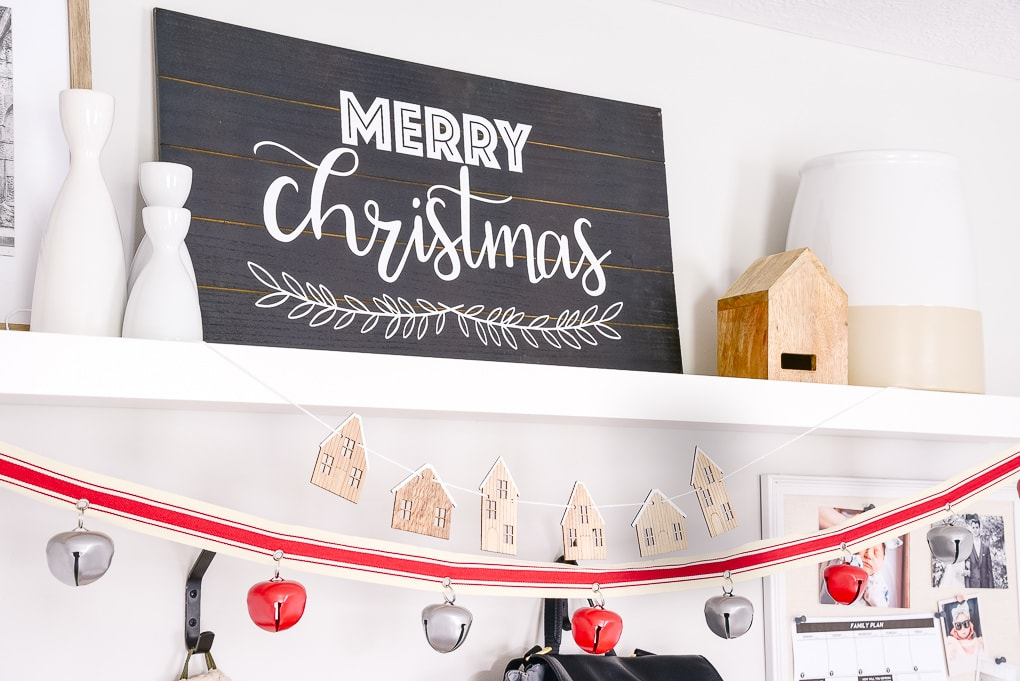 merry christmas black and white sign on white shelf in a mudroom