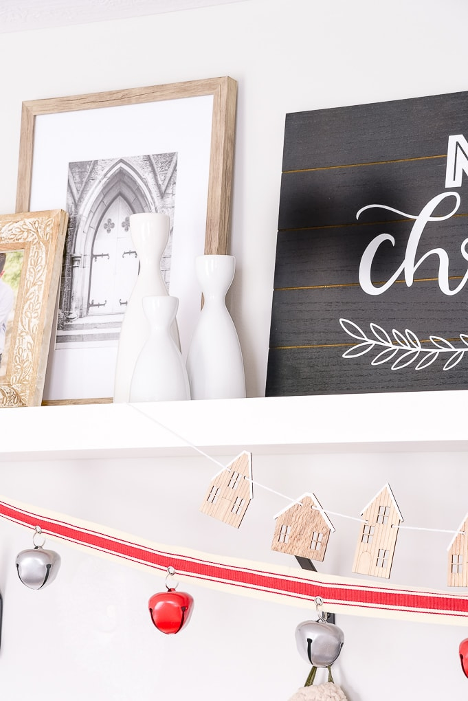 white candle holders on white shelf decorated mudroom christmas