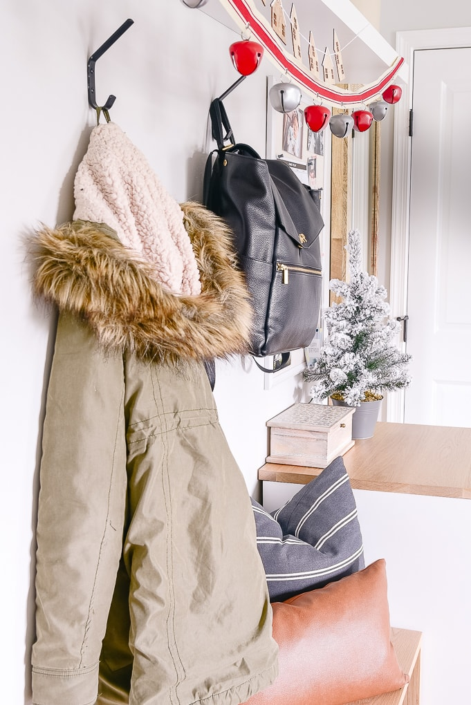 coats hanging in mudroom decorated for christmas