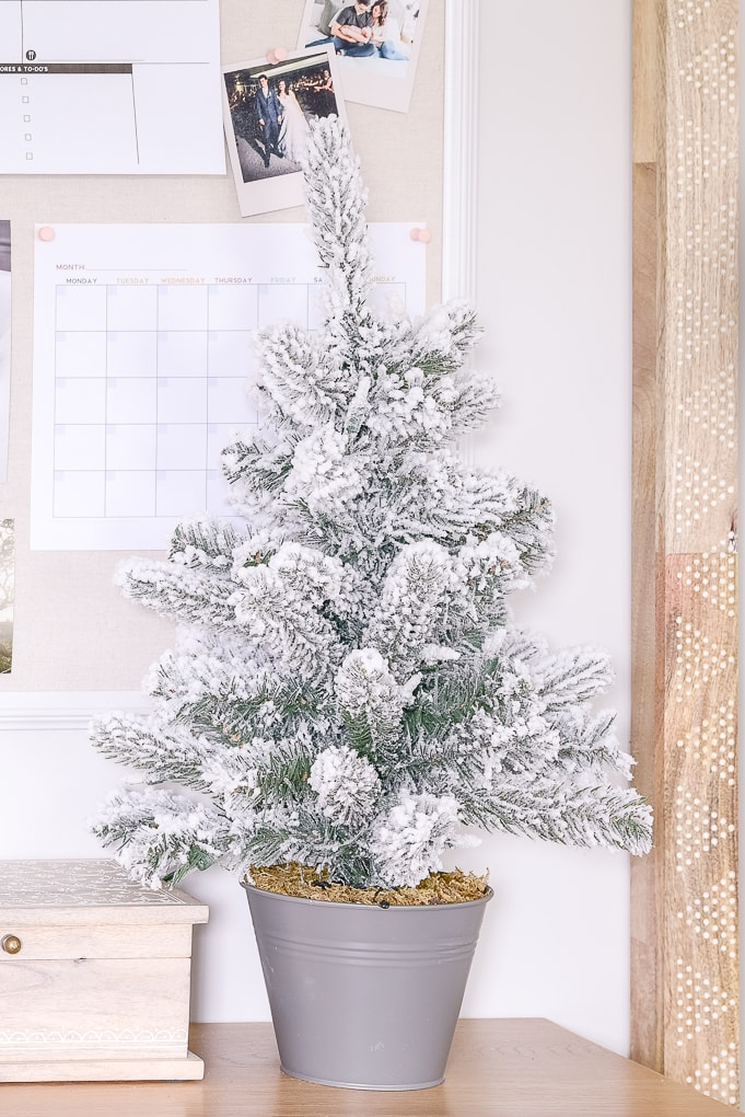 small tabletop flocked Christmas tree