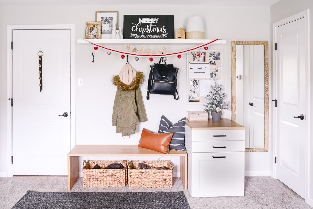 mudroom and entryway decorated for christmas