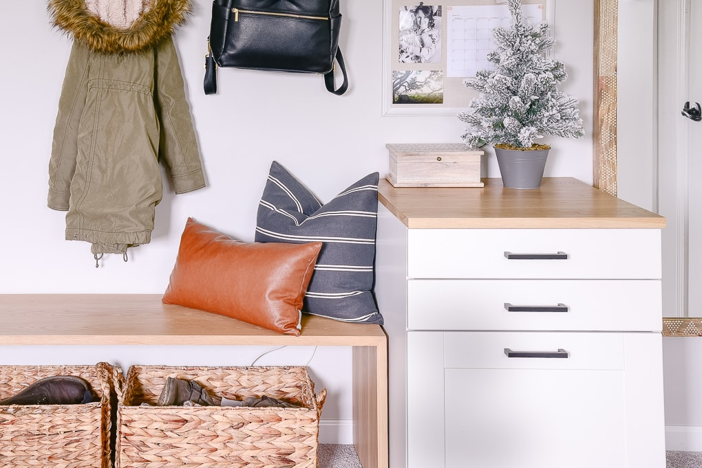 mudroom details bench pillows and tabletop christmas tree